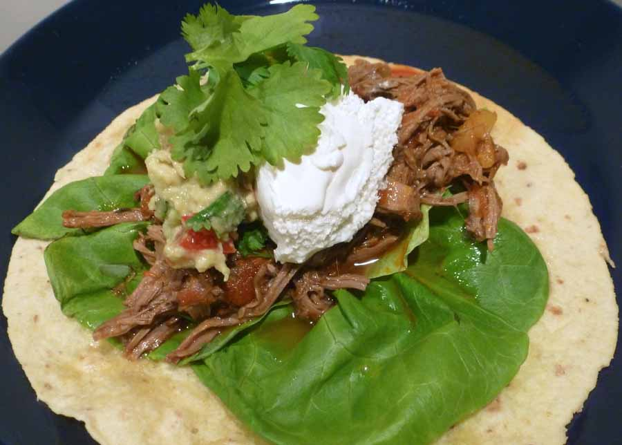 Notafraidofbutter.nl| Beef brisket chili on a flour taco with fresh guacamole, sour cream and cilantro