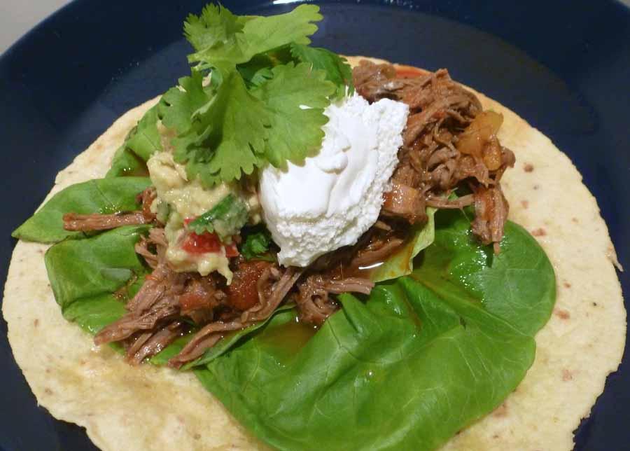 Notafraidofbutter.nl| Beef brisket chili on a flour taco with fresh guacamole, sour cream and cilantro